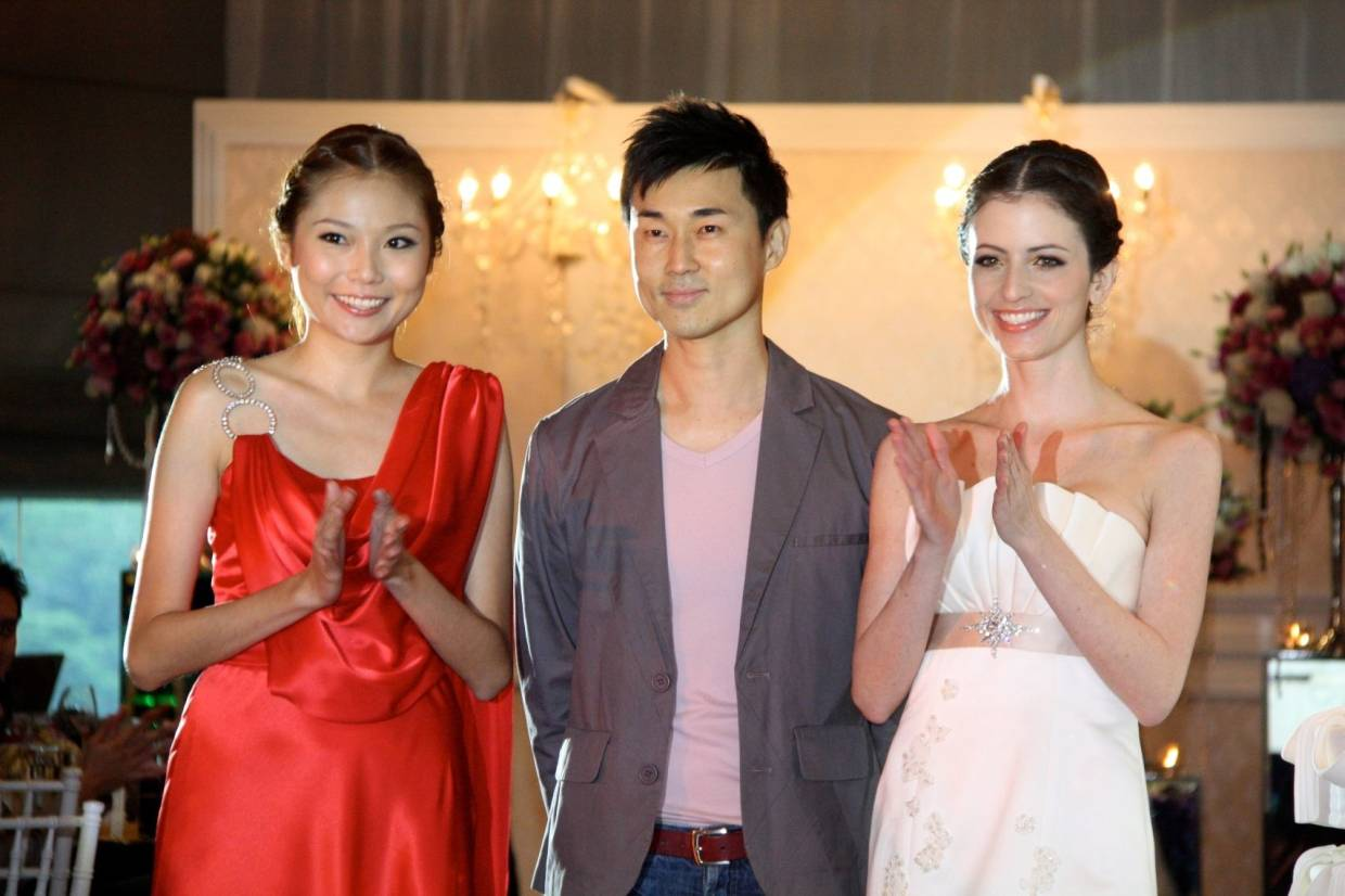 A 2012 photo of Ong with his models. His experience in fashion has span decades.