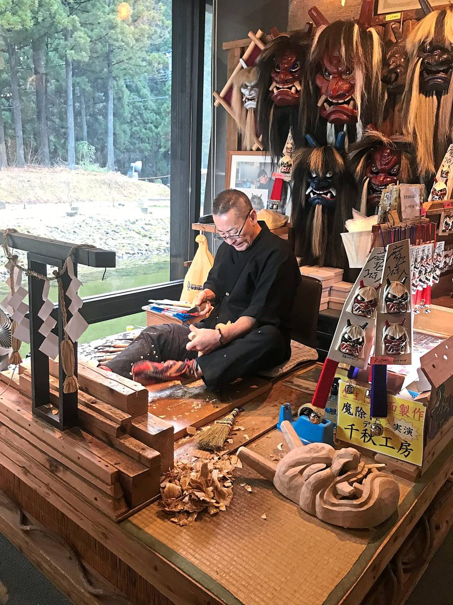 A craftsman carries on the tradition of carving Namahage masks.