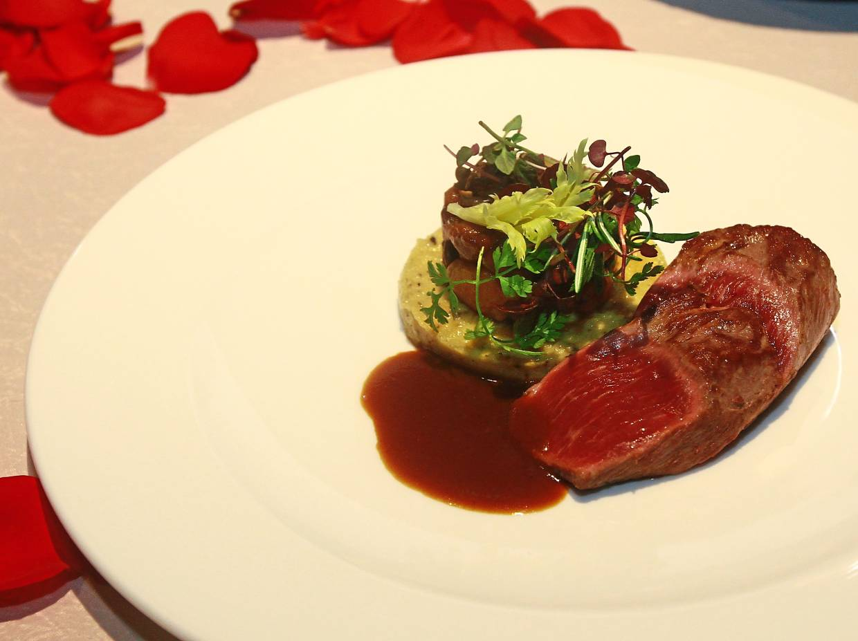 Lamb Loin with Truffle Chickpea Puree and Sautéed Mushrooms in Jus Reduction.