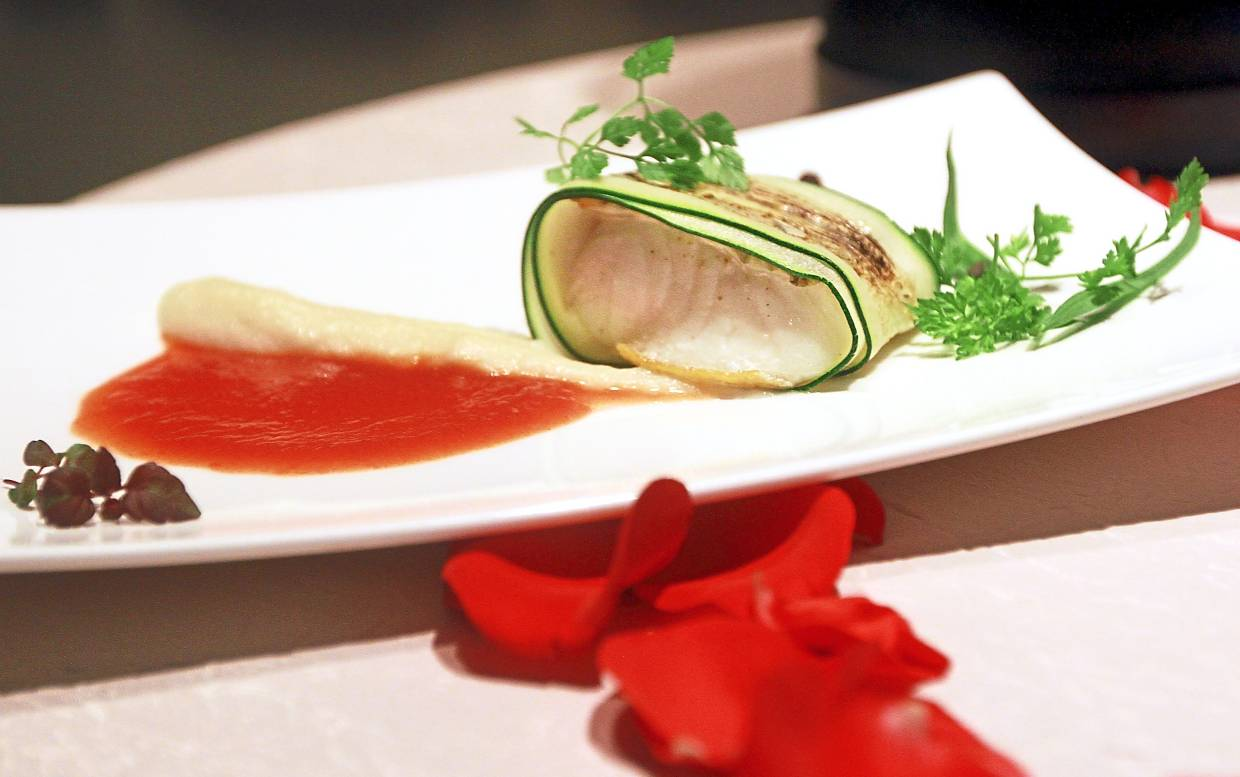 Cod Wrapped in Zucchini with Celeriac Puree and Tomato Essence.