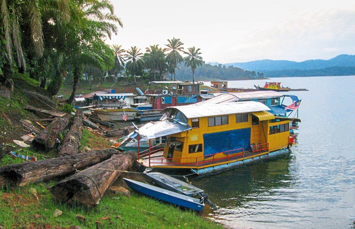 The many boathouses which anglers can charter for fishing expeditions in Kenyir.