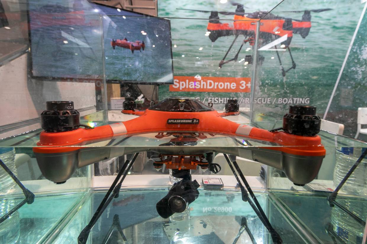 The Swellpro SplashDrone 3+ waterproof drone is displayed in water at the 2020 Consumer Electronics Show (CES) in Las Vegas, Nevada. — AFP