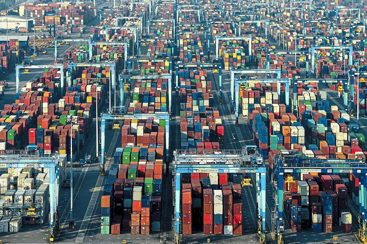 Busy port: Shipping containers in Westports in Port Klang. The port operator handled 10.86 million TEUs of containers last year. — AFP