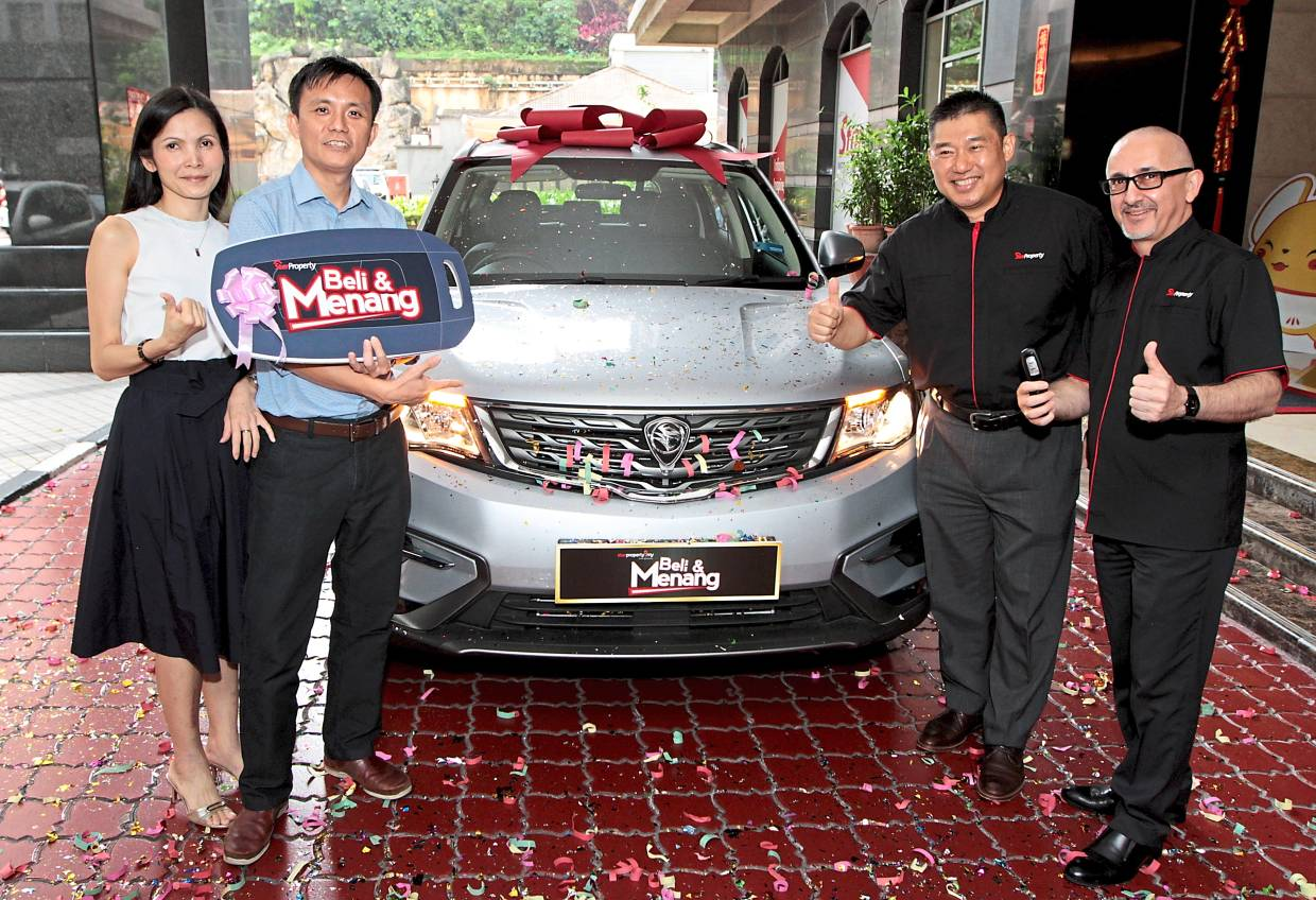 Lucky winner: Wong (second from left) with his wife, Chervin Sam, are all smiles after winning the Proton X70. Sharing his joy are, Vogiatzakis (right), and Towle.