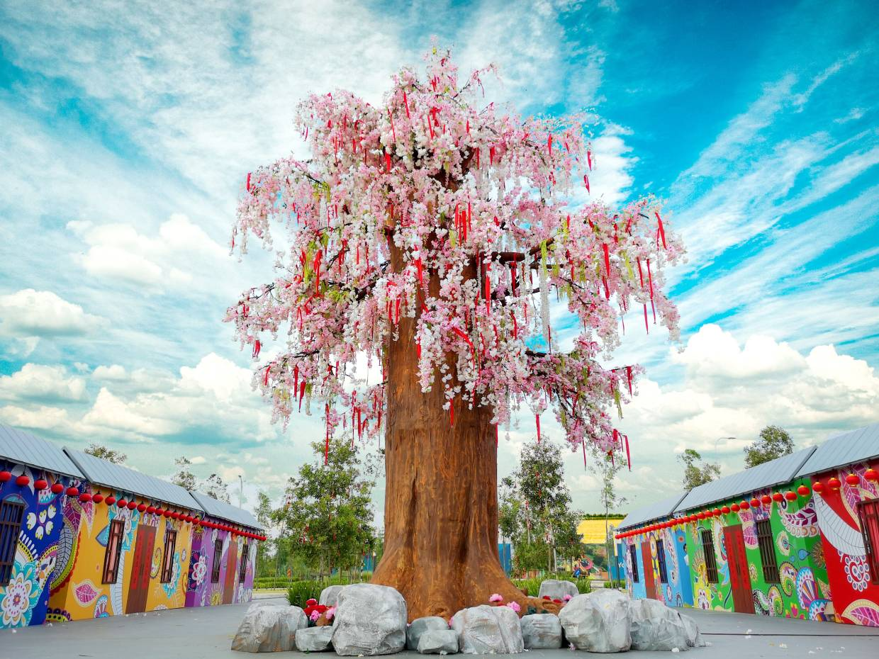 While you're there, visit the 30ft cherry blossom tree replica at Gamuda Cove.