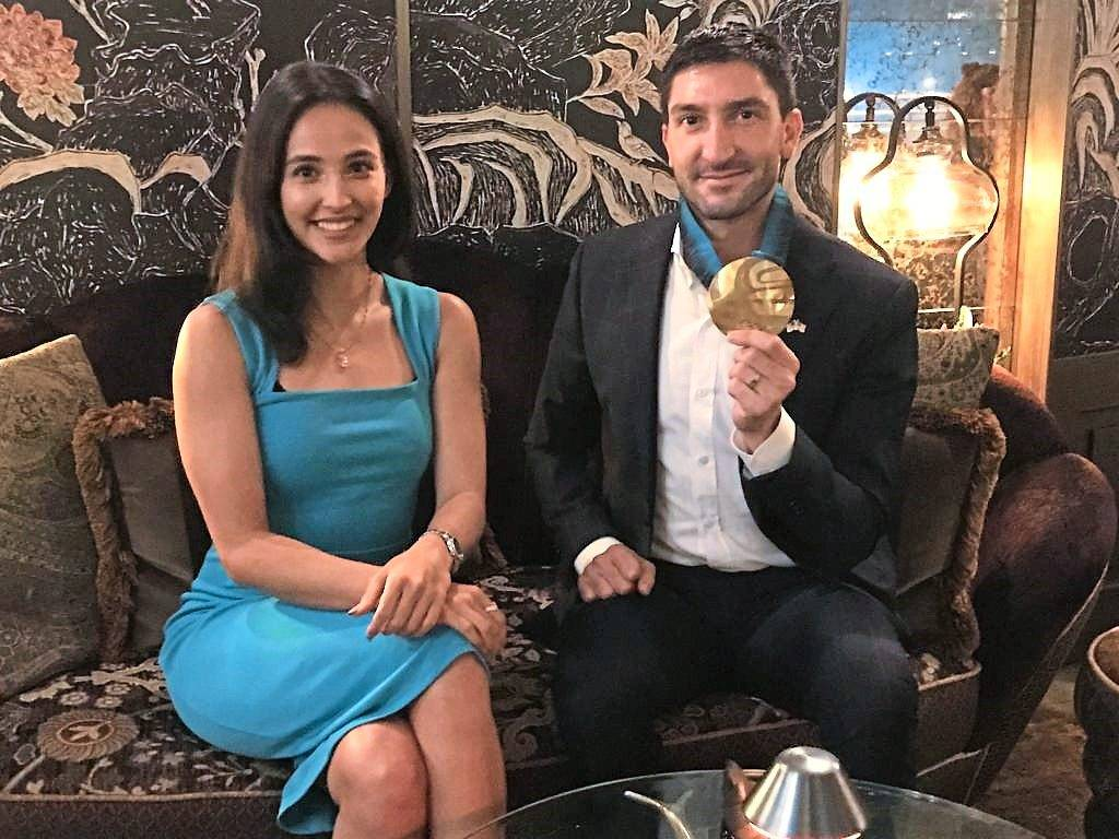 Evan Lysacek (right) poses with his gold medal with national gymnast Farah Ann Abdul Hadi.