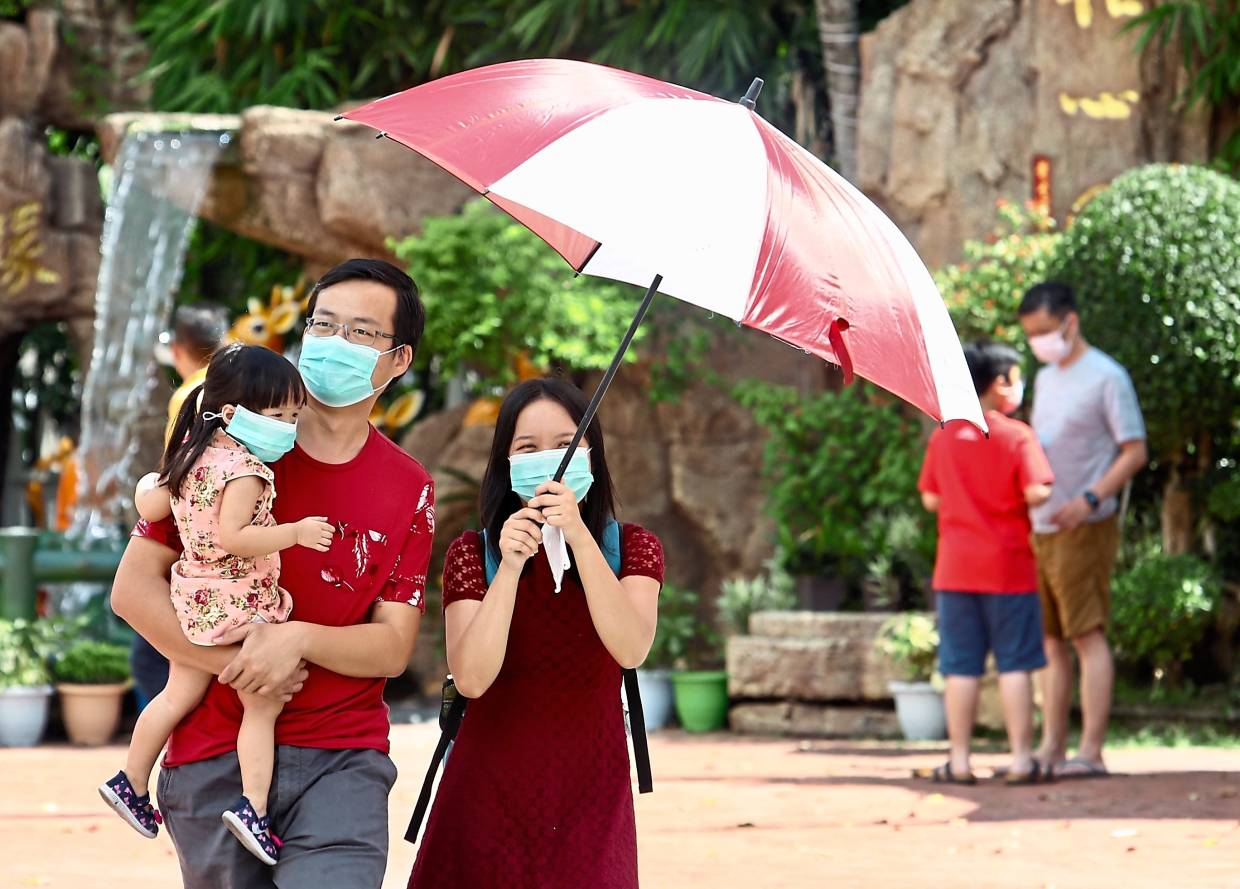 Visitors to the popular Thean Hou temple in KL wearing face masks as the coronavirus outbreak heightens. —  FAIHAN GHANI/The Star