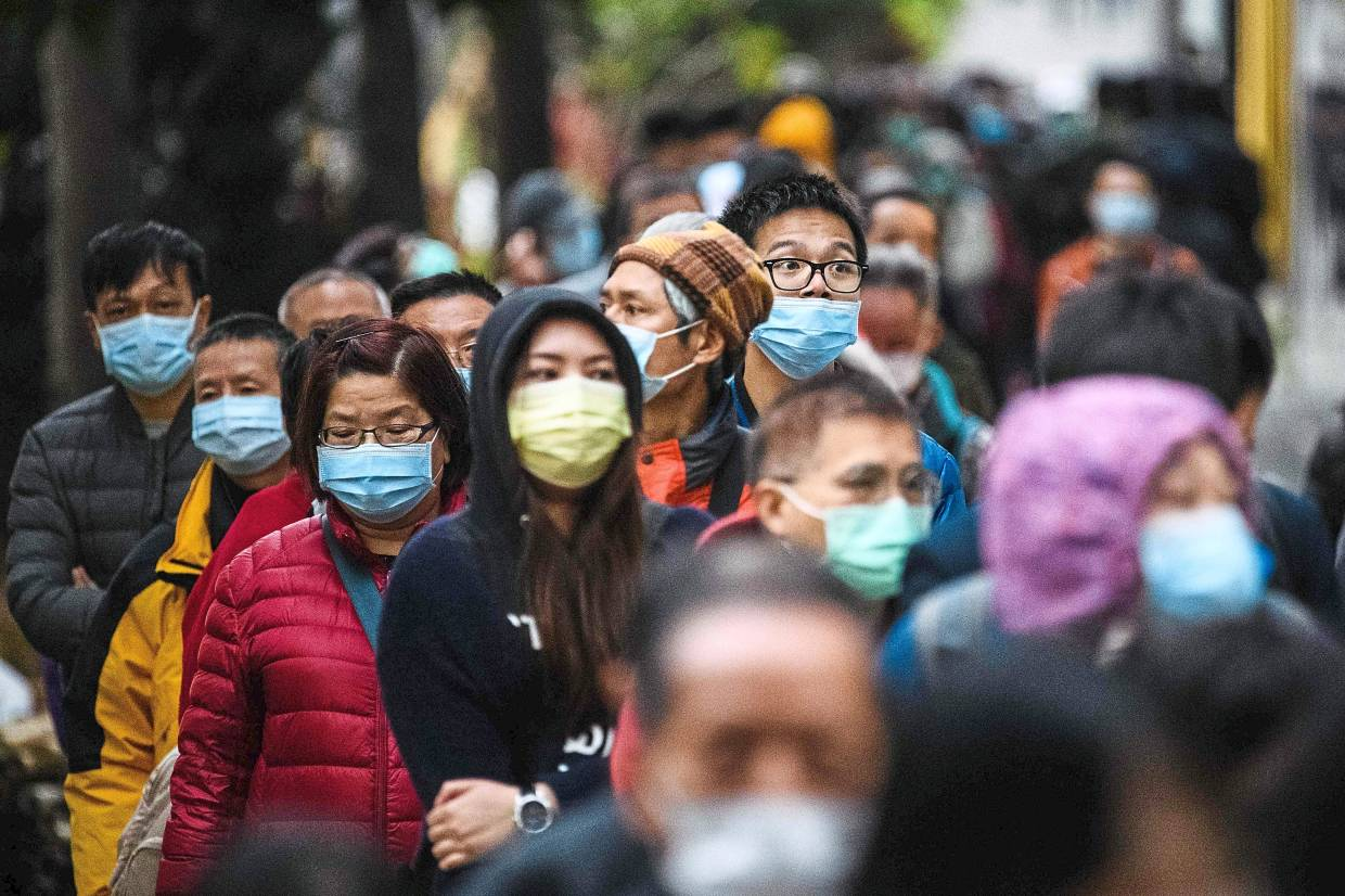 Coronavirus is extremely contagious, and unlike SARS, can spread even during the incubation period when no symptoms are present. — AFP