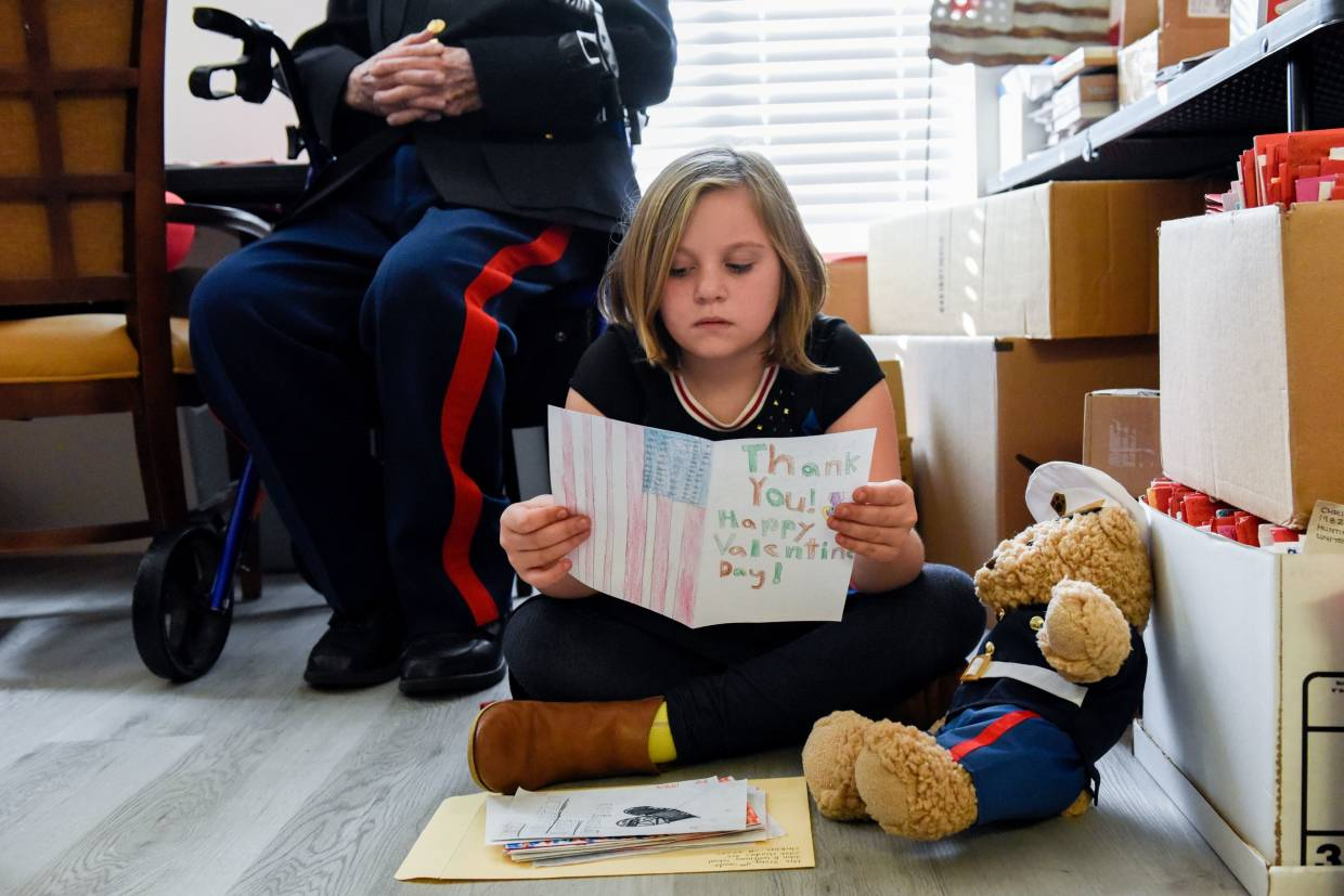 Abigail Sawyer, nine-year-old great granddaughter of White, reads Valentine's Day cards sent to him in Stockton, California, US.