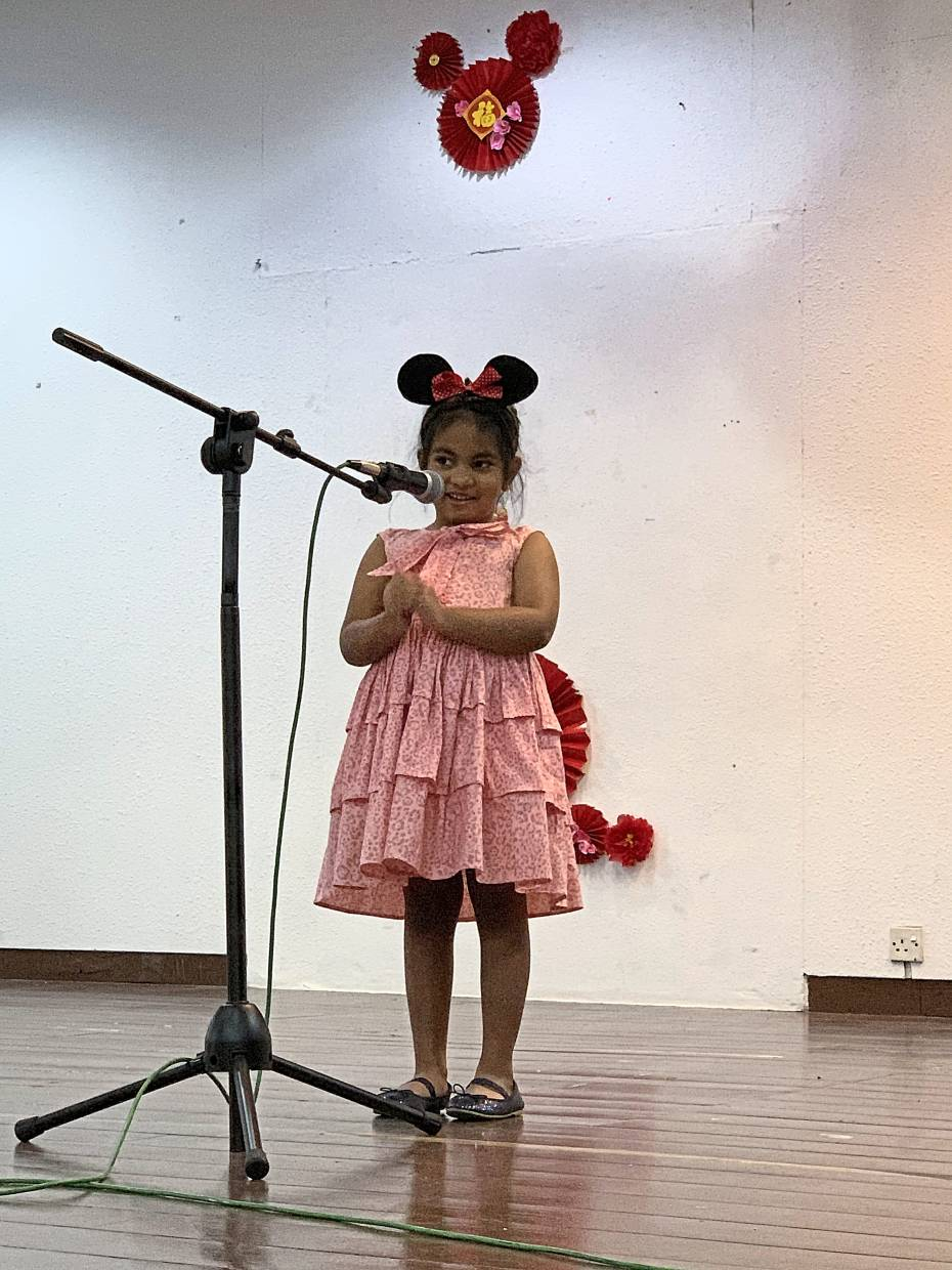 Six-year-old Yadhavi performing a Chinese New Year song.