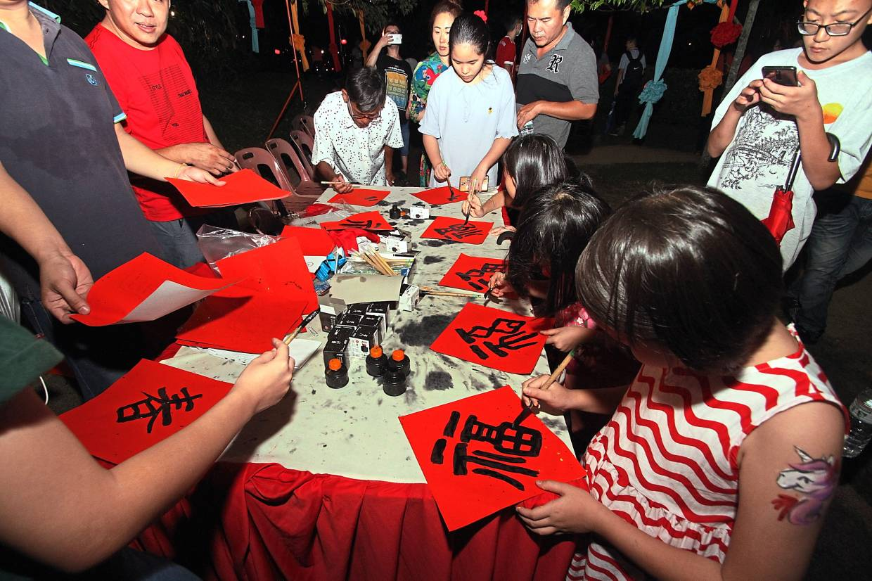 Guests showing their creativity during a Chinese calligraphy writing event at the lunar new year do.
