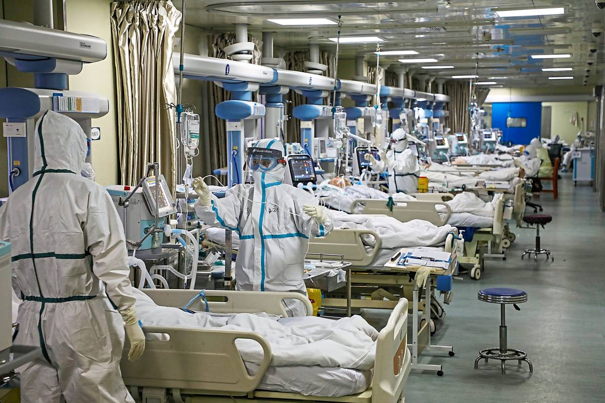 Medical workers in protective suits attend to novel coronavirus patients at the ICU of a Wuhan hospital. An undisclosed number of doctors and nurses have succumbed to the infection in the line of duty. — China Daily via Reuters