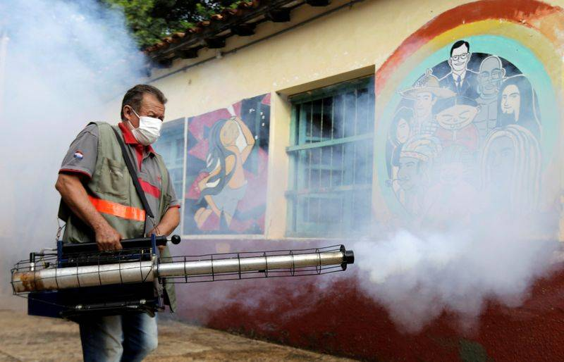 FILE PHOTO A federal health worker takes part in fumigation to prevent the proliferation of mosquitos that transmit the Dengue fever at the San Lorenzo National School in a low-income neighbourhood of San Lorenzo Paraguay February 12 2020. REUTERSJorge Adorno