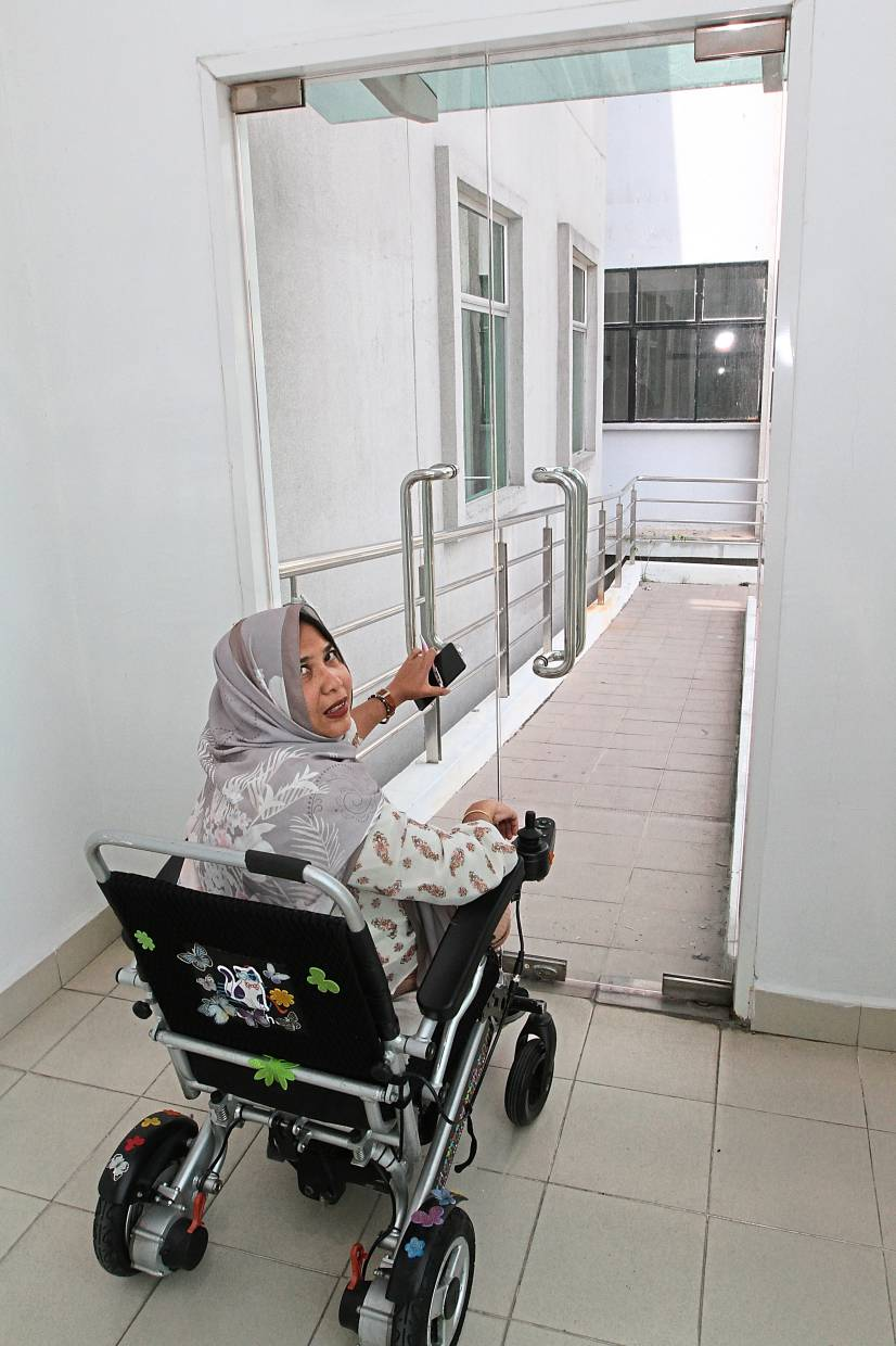 Dr Noraishah says ramps in newer buildings cannot be accessed because the doors are locked.