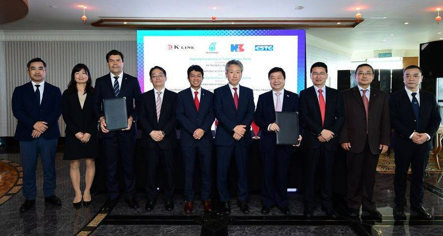 """Signatories and witnesses from Petronas LNG, """"K"""" Line and Hudong-Zhonghua Shipbuilding following the time charter party and shipbuilding contract signing ceremony. The ceremony was held at the Malaysian Petroleum Club, PETRONAS Twin Towers."""