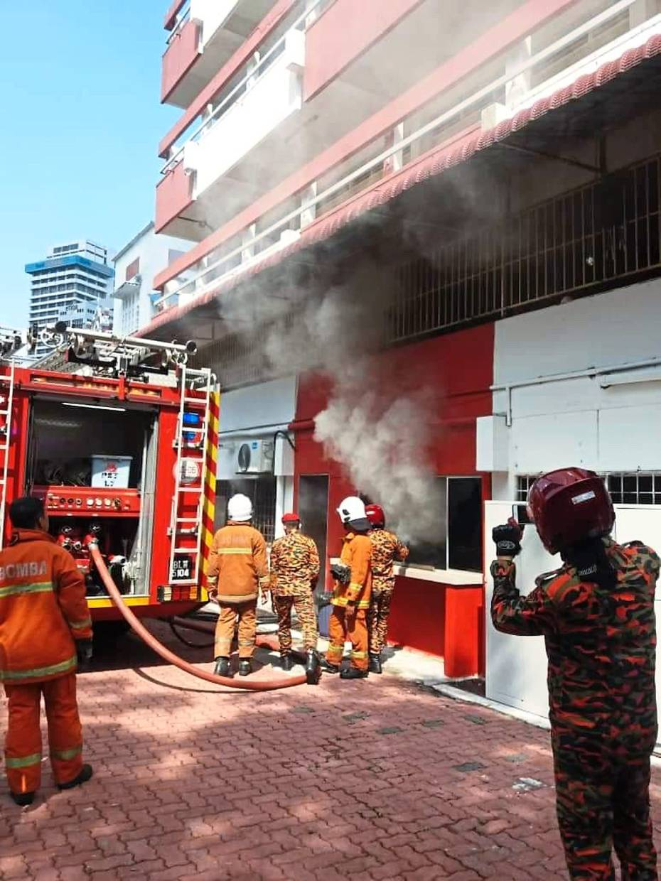 Cause for concern: Firefighters containing the situation as they investigate the source of the smoke.