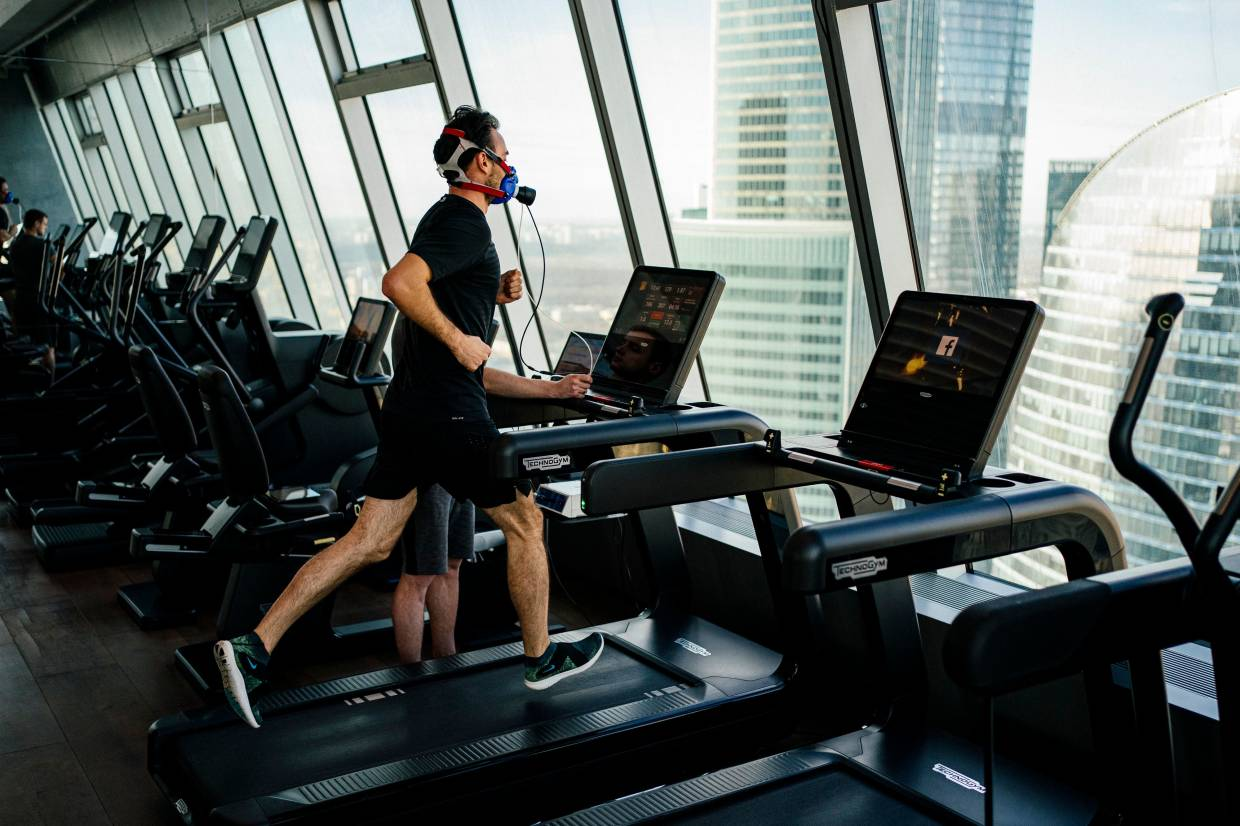 Igor Korabelnikov exercises on a treadmill wearing a facemask to analyse the gases in his breath at a gym that calls itself a 'biohacking laboratory' on the 58th floor of a skyscraper in the Moscow business district.