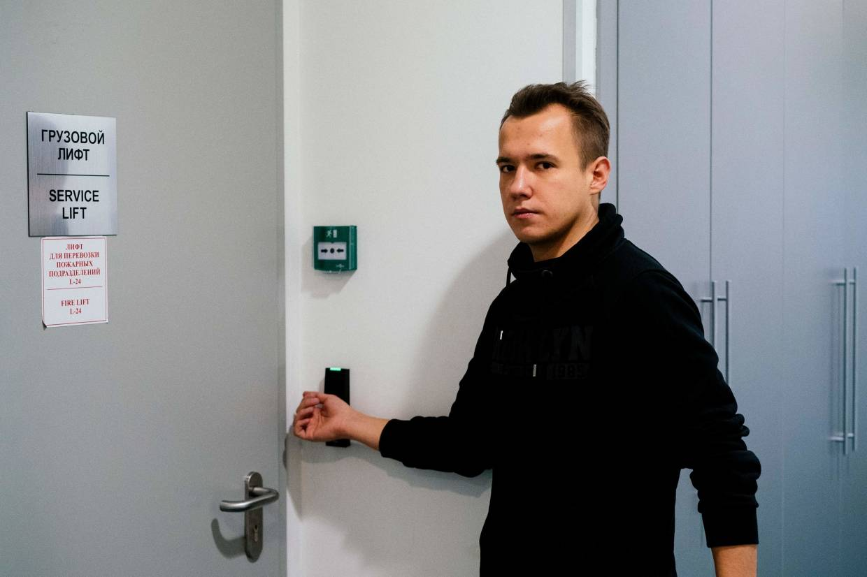 Rautkin, 24, uses his chipped hand to open a door at his e-commerce company in Moscow.