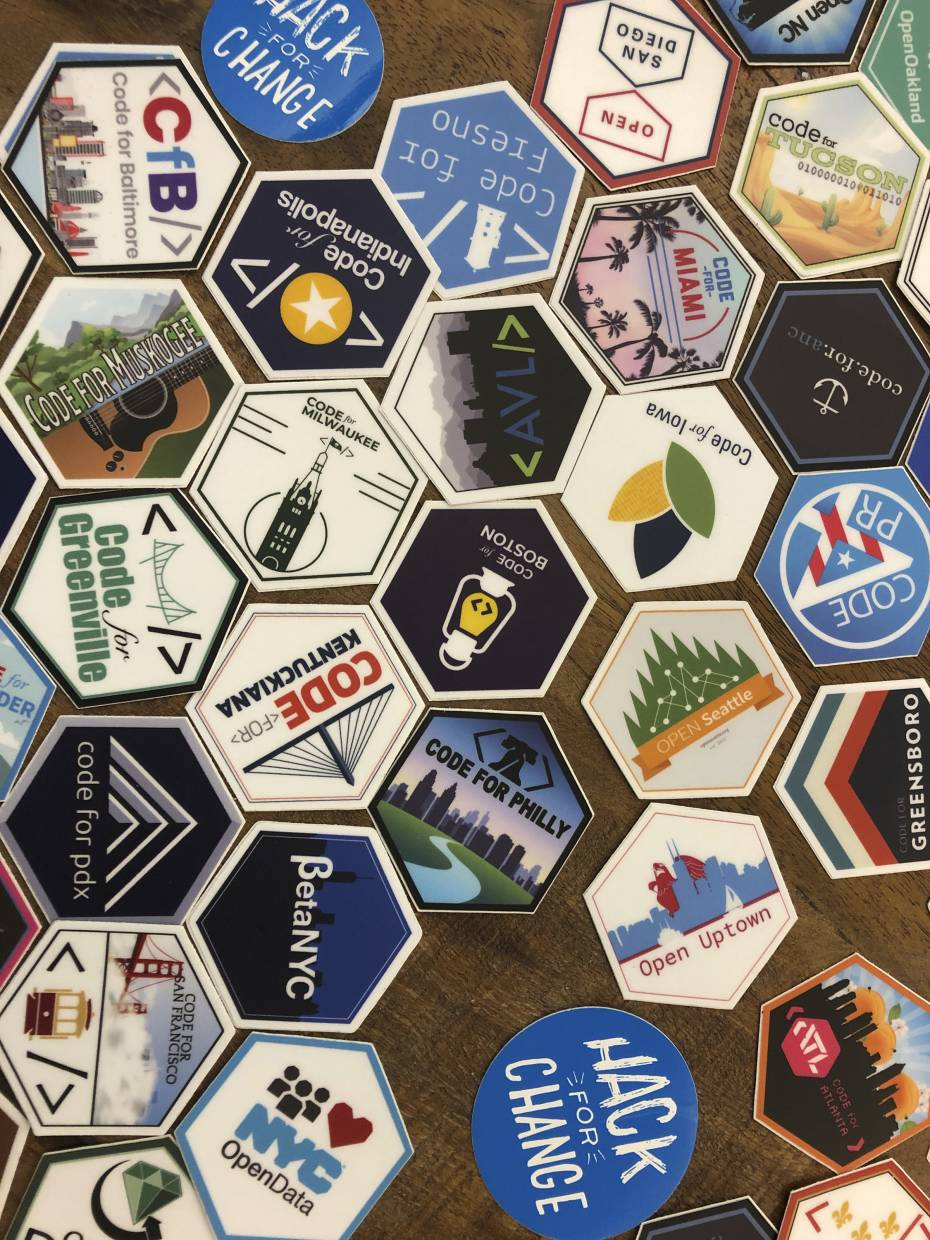 An array of stickers from Code For America brigades across the United States and Puerto Rico are displayed at a meeting in Denver of the group Code For Denver, a volunteer information technology assemblage. Code For Denver is one of dozens of groups nationwide in which information technology professionals volunteer their expertise on projects for local municipalities and nonprofit organisations.