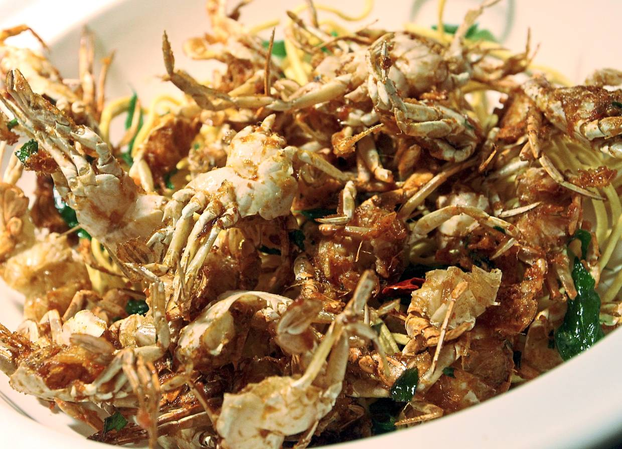 Crispy Fried Baby Crab with Local Spice (below) and Black Pepper Crab.