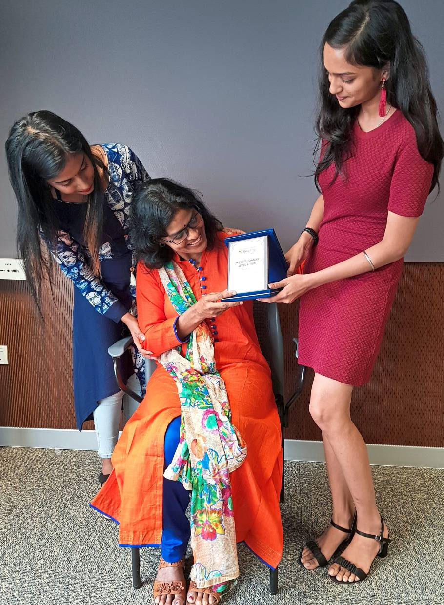 Kausalya (right) showing her award to her mother Jayanteh (seated). Looking on is her sister Jaya Rani.