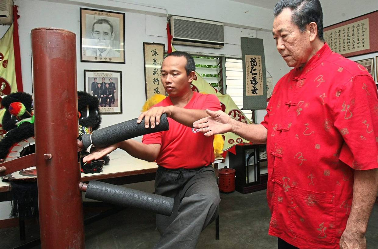Revered artform: Fook Choy (right) also taught Kahar the lion dance, after learning it himself from Yip Kin.