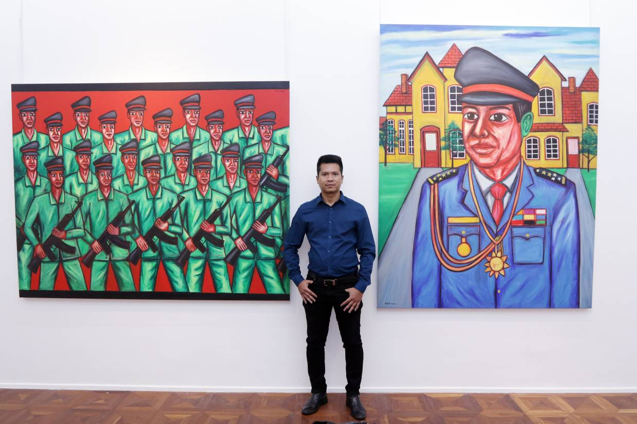 Pen Robit's exhibition also offers military-themed works, including 'The Soldiers' (left) and 'Commander-In-Chief' (oil on canvas, 2020). Photo: The Star/Izzrafiq Alias