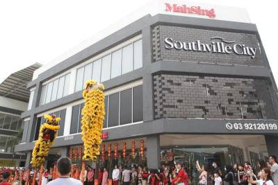 Lion dance troupe performs at Southville City's Chinese New Year open house event earlier this month. Mah Sing is targeting to achieve RM1.6bil this year.