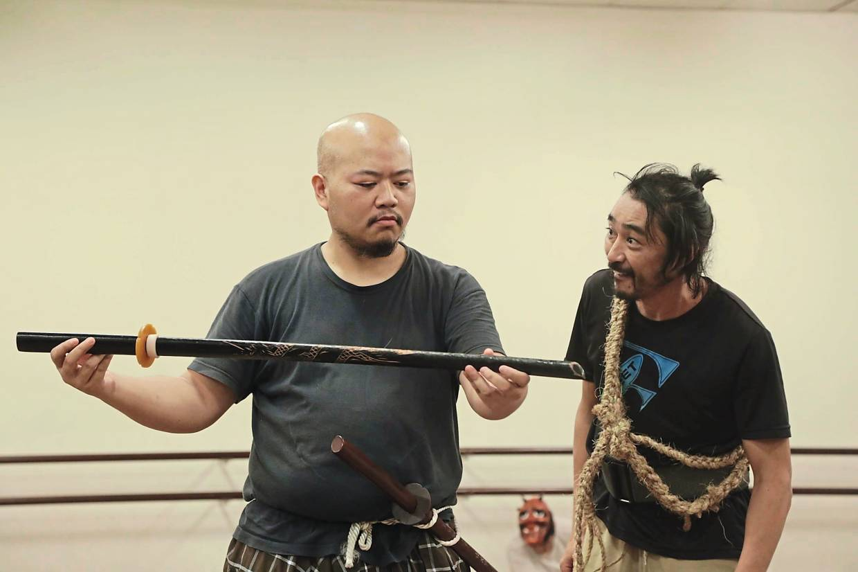 How do you make a samurai run? 'You sho gun'. The Samurai (Omar Ali) examines a sword while the Bandit (Doppo Narita) looks on during a rehearsal night. Photo: The Actors Studio