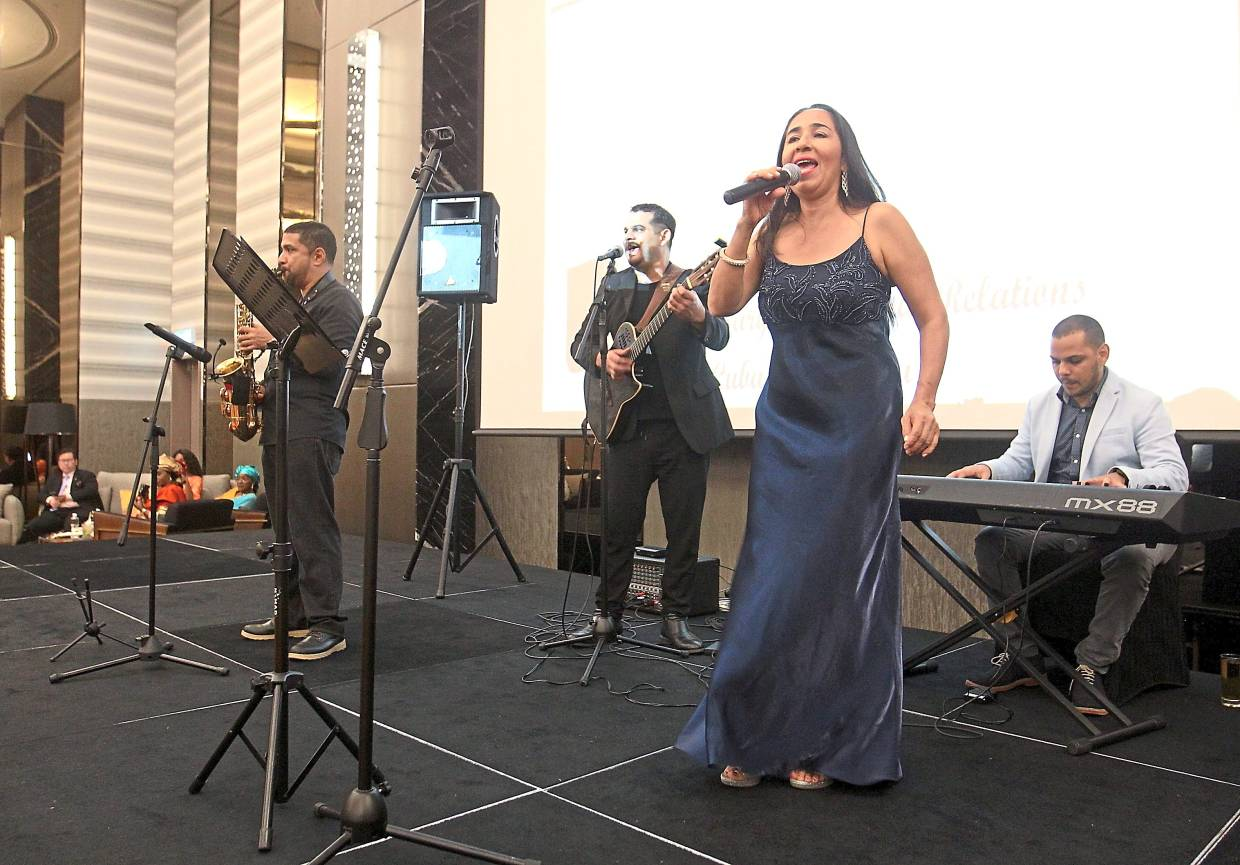 A live band serenading guests at the event.