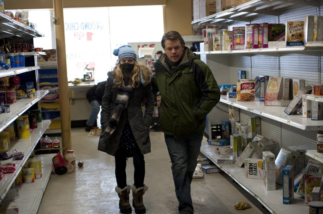 Anna Jacoby-Heron, left, and Matt Damon are shown in a scene from the film 'Contagion'. — AP/Warner Bros Pictures