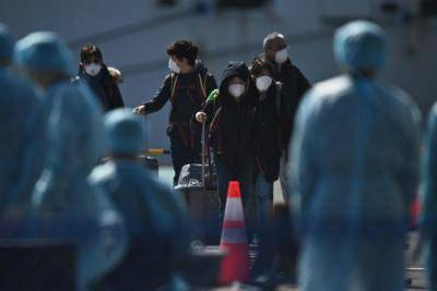 China reports 118 more virus deaths as toll rises to 2,236