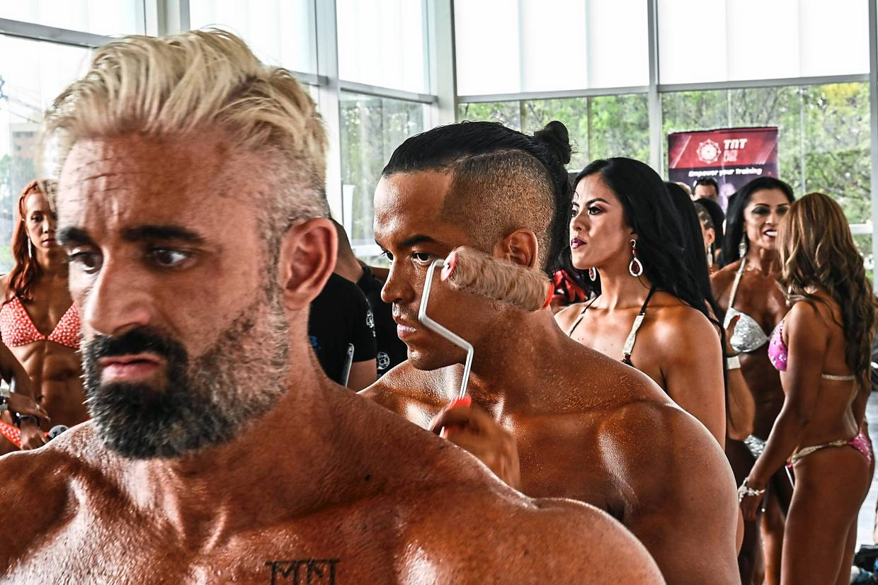 Bodybuilders often have thick necks, like these men lining up to go on stage at the Olympia Amateur 2020 contest in Medellin, Colombia. — AFP