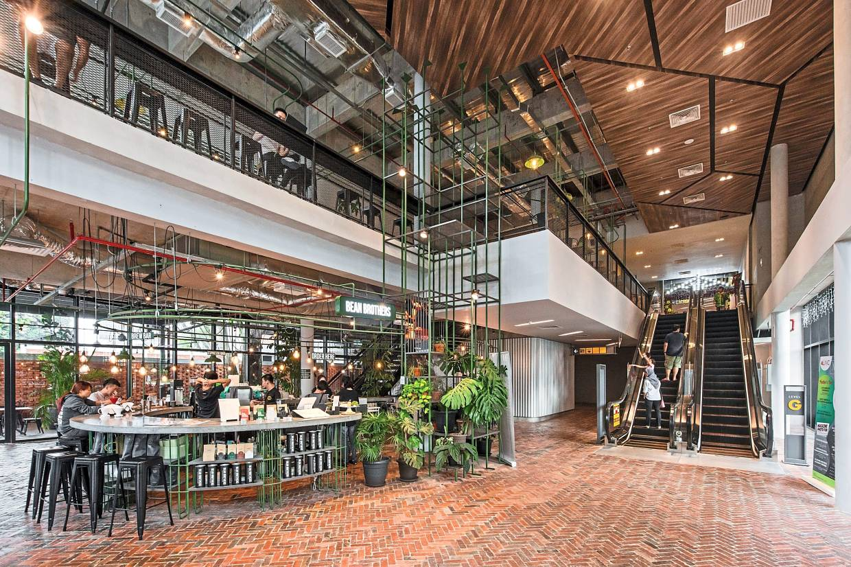 The interior of the two-storey building features raw concrete walls, black steel fittings and herringbone brick flooring that create a warm and relaxed atmosphere.