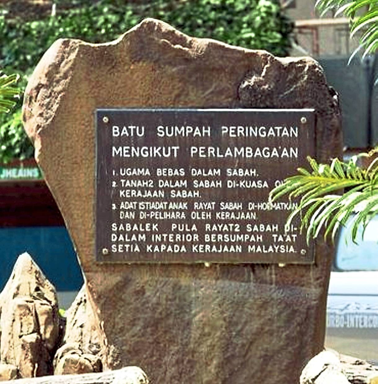 Sacred words: The phrase 'Kerajaan Malaysia Jamin' was erased from the plaque when it went missing a few  years ago.
