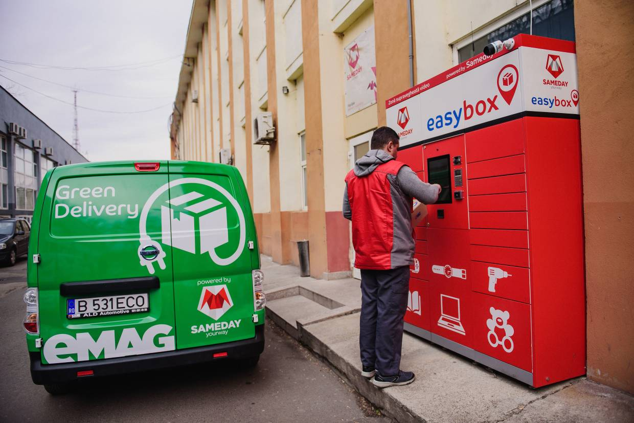 An eMag online retail courier delivers a package to customer order delivery lockers in Bucharest, Romania.