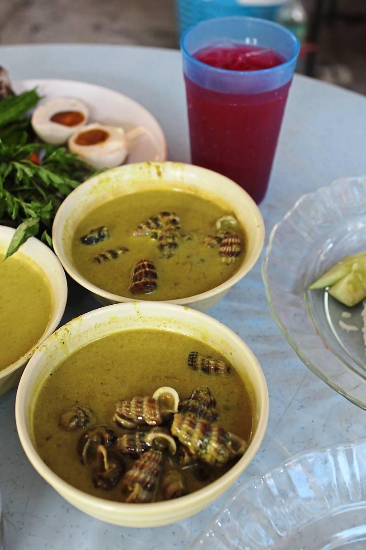 Siput sedut masak lemak cili api served in small bowls at Nasi Raja Salai, Kampung Sungai Kandis in Shah Alam.