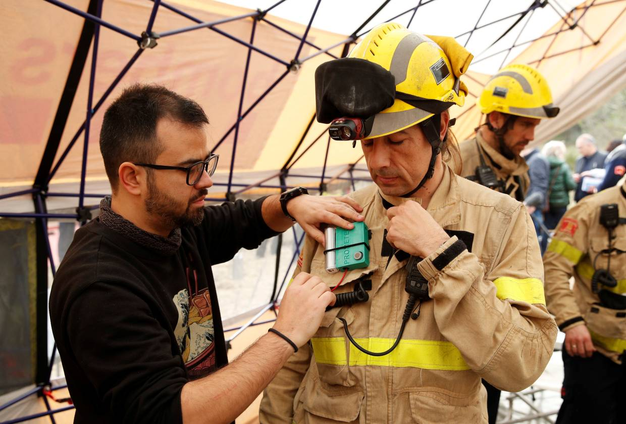 A Prometeo monitoring device (by IBM) is attached to firefighter's suit during prescribed burn of the forest in Olivella, south of Barcelona, Spain.