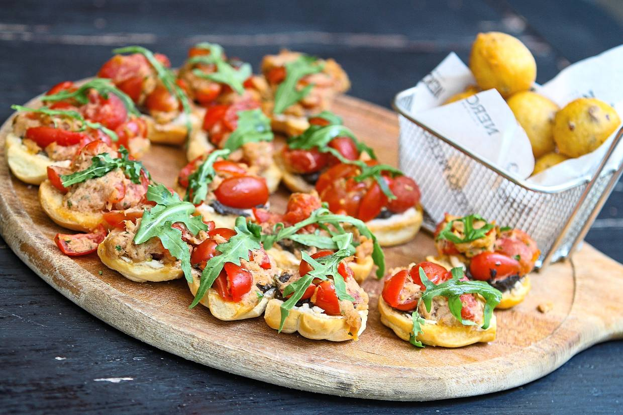 Crostini with ricotta cheese, cherry tomatoes, tuna and olives tapenade. — Photos: MUHAMAD SHAHRIL ROSLI/The Star