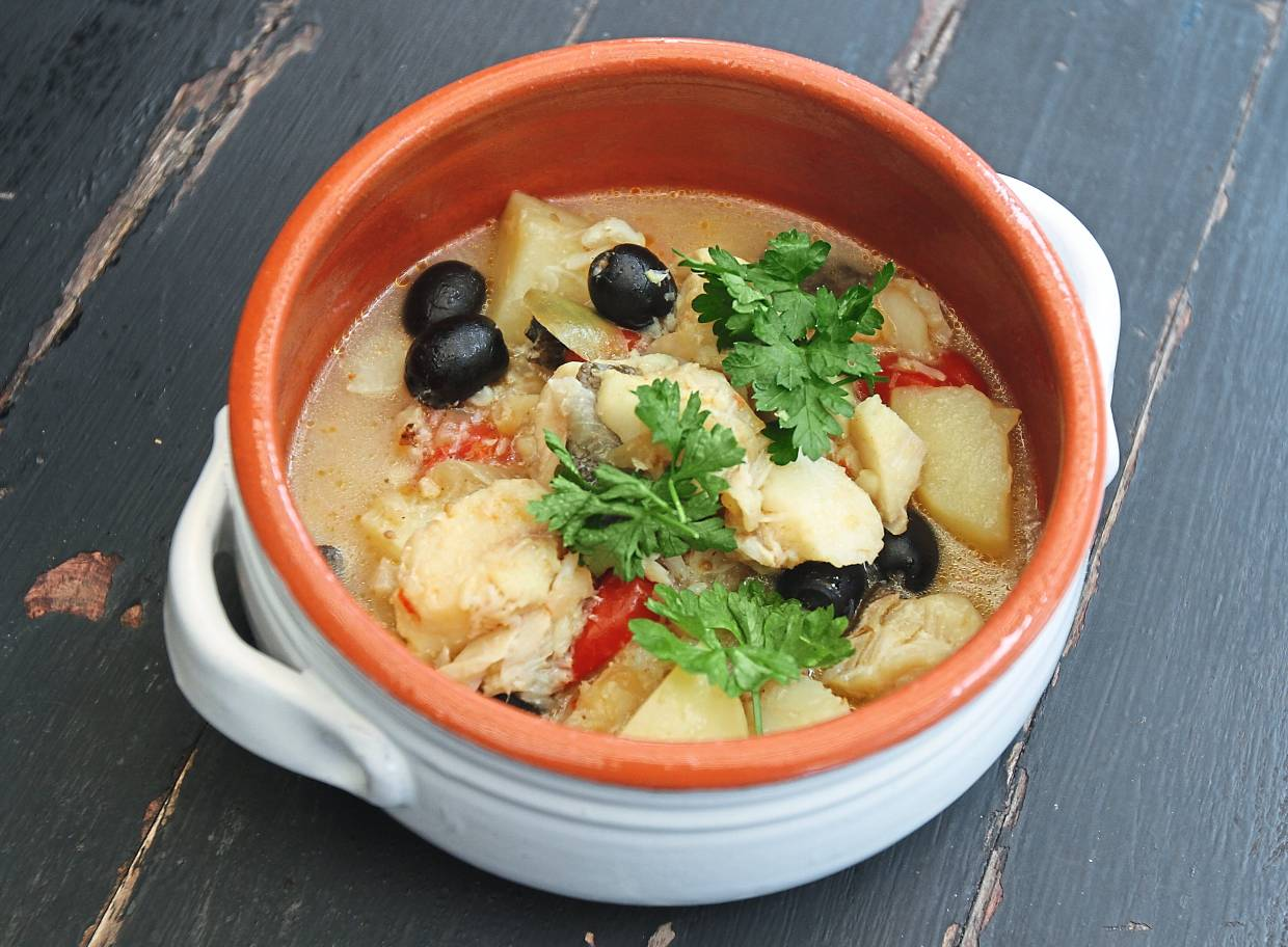 Salted cod fish stew with potatoes and olives.