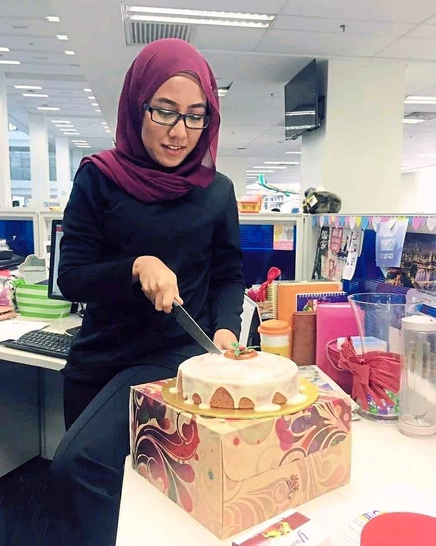 Nabila celebrating her 28th birthday in 2016 at her office.
