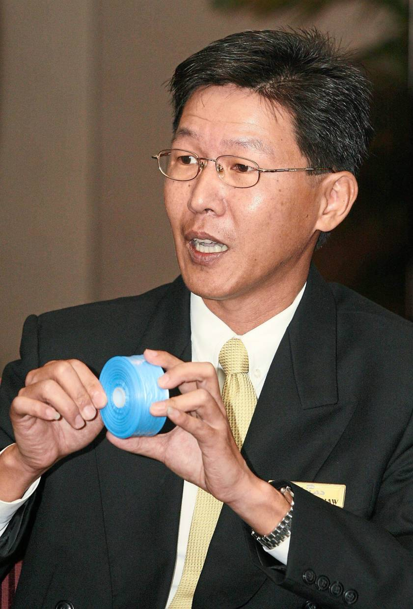 SLP Resources Bhd executive director Kelvin Khaw showing one of the group's plastic products