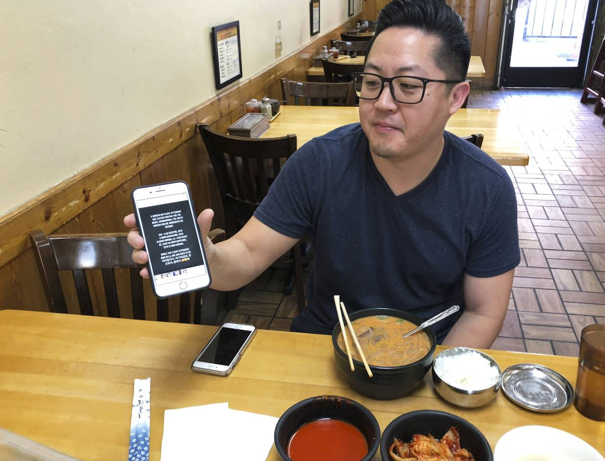 Won showing the message that spread the rumour on social media, while he was eating at Han Bat Shul Lung Tang restaurant in Los Angeles. Han Bat Shul Lung Tang was one of five restaurants that lost business after being named in posts on a Korean messaging app that warned a Korean Air flight attendant with the virus had dined there during a layover in Los Angeles more than a week ago.