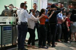 Hostages free in Philippine mall stand-off; former guard surrenders (latest)