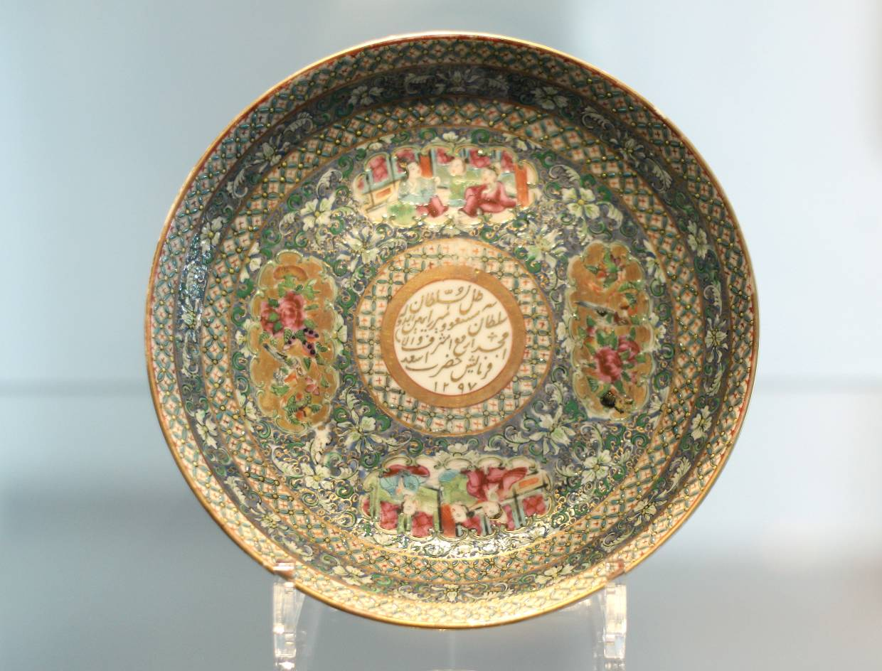 The Canton Familie Rose Dish dates back to 1879 in China. The central medallion bears the name and title of Prince Masoud in Nasta'liq script. Photo: The Star/Azman Ghani
