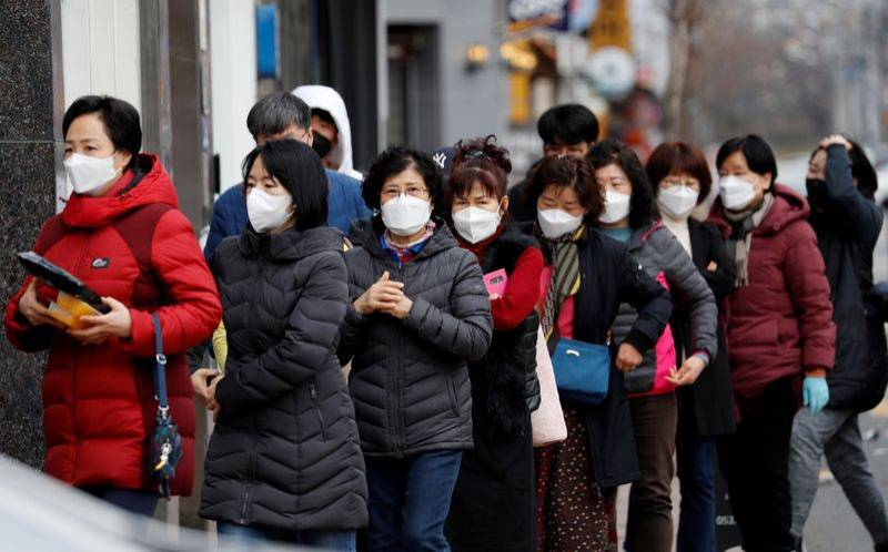 People wearing masks stand in a line to buy face masks in front of a drug store amid the rise in confirmed cases of the novel coronavirus disease of COVID-19 in Daegu South Korea March 3 2020. REUTERSKim Kyung-Hoon