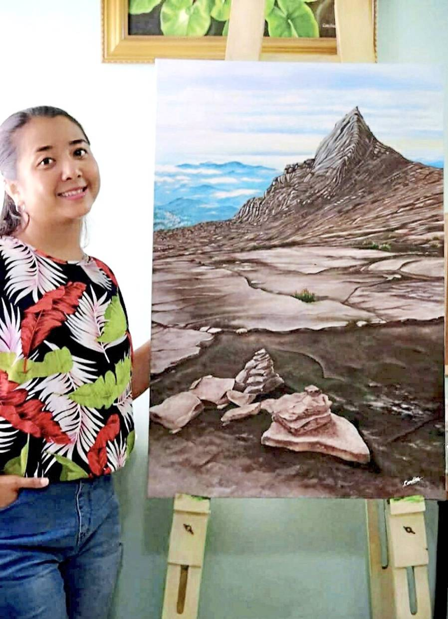 Candice Wong with her painting, Destination To The Summit. 'Through art, I am able to express my feelings and vision, ' she says.