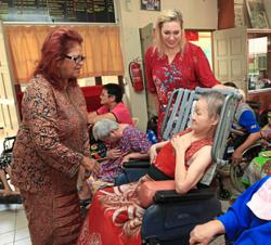 Latin women's association gives RM21,500 to home for disabled