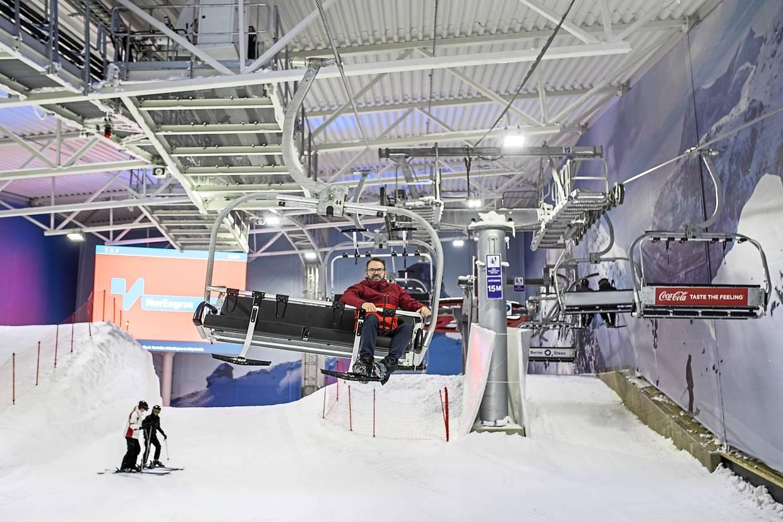 Morten Dybdahl, managing director of Sno, rides on a ski lift at the indoor skiing resort in Lorenskog, Norway. — Bloomberg
