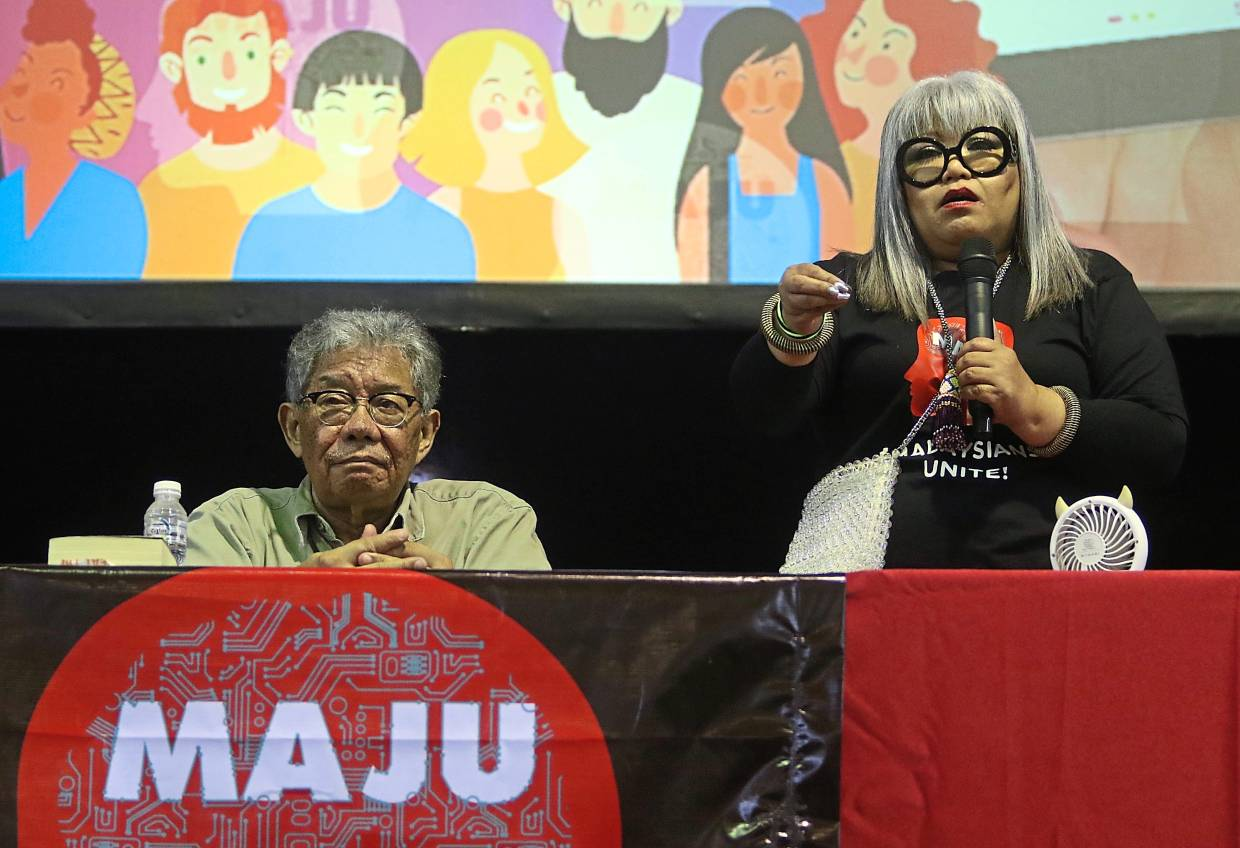 Siti Kasim giving a speech at the Maju roadshow. With her is Mohamed Tawfik.